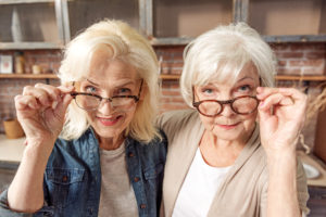 Craft & Communicate | Senior female friends observing something interesting