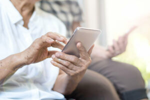 Craft & Communicate | Seniors using smartphones outdoors