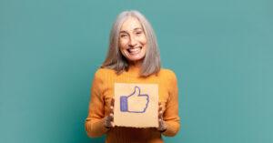 Craft & Communicate | Senior holding a facebook like button